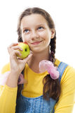 Young teenager girl with apple standing royalty free stock photo