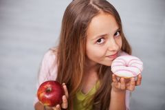 Young teenager girl craving sugary food Royalty Free Stock Photography