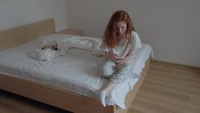 Young teenager girl with mobile phone on the bed. stock video footage