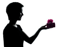 Young teenager girl offering present Stock Images
