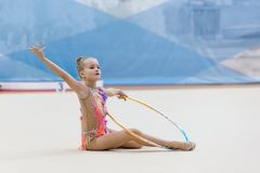 A young teenager girl performs at competitions in rhythmic gymnastics. Competitions in rhythmic gymnastics, Russia, September 2017 Royalty Free Stock Photography