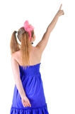 Young teenager girl points at wall. Royalty Free Stock Photo