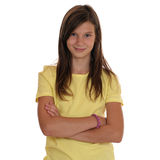 Young teenager girl portrait with folded arms. Isolated on a white background Stock Photos