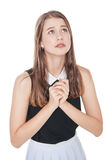 Young teenager girl praying isolated Royalty Free Stock Photography