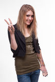 Young teenager girl showing victory sign Royalty Free Stock Image