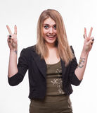 Young teenager girl showing victory sign Stock Images