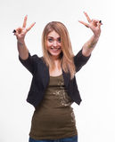 Young teenager girl showing victory sign Royalty Free Stock Photos