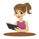 Young teenager girl using tablet computer Stock Image