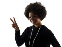 Young teenager girl woman peace sign gesture shadow silhouette i. One mixed race african young teenager girl woman peace sign gesture in studio shadow silhouette Stock Image