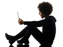 Young teenager girl woman using digital tablet shadow silhouette royalty free stock photography