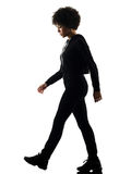 Young teenager girl woman walking sadness shadow silhouette isol Royalty Free Stock Photo