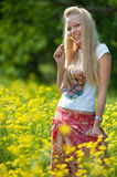 Young teenager girl with yellow flower Stock Photos