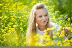 Young teenager girl with yellow flower Royalty Free Stock Images
