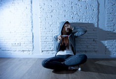 Young teenager girl or young woman in shock scared after positive pregnancy test Royalty Free Stock Photos