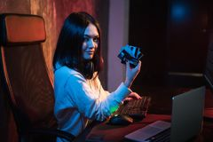 Young teenager hacker girl in hoodie holding credit card violating private password holding credit card in cybercrime. And cyber crime concept and internet stock photo
