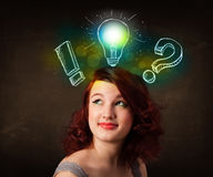 Young  teenager with hand drawn light bulb illustration Royalty Free Stock Images