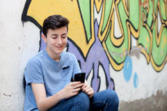 Young teenager with her cell phone Stock Images