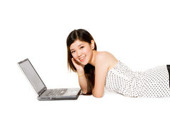 Young teenager with her laptop computer. Young teenager with a beautiful smile and her laptop computer Royalty Free Stock Photo