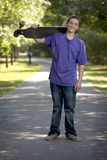Young teenager holding his longboard Royalty Free Stock Photography