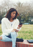 Young teenager holding mobile phone Stock Photos