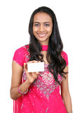 Young teenager holding a name card. Isolated on a white background Royalty Free Stock Photography
