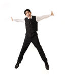 Young  teenager jumping in joy. Isolated over white background Royalty Free Stock Photos