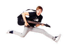 Young Teenager Jumping With Guitar Stock Photos