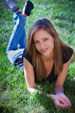 Young teenager laying on grass Royalty Free Stock Images