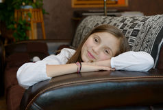 Young teenager lying on the sofa. At her home Royalty Free Stock Photo