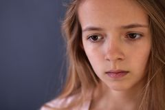 Young teenager portrait of a sad or worried gir stock photo