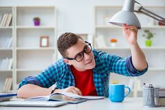 The young teenager preparing for exams studying at a desk indoors Royalty Free Stock Photography