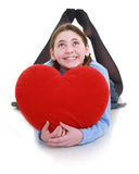 Young teenager with red heart. A young teenager with red heart Royalty Free Stock Image