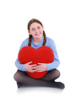 Young teenager with red heart. A young teenager with red heart Royalty Free Stock Images