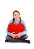 Young teenager with red heart. Isolated on white background Royalty Free Stock Image