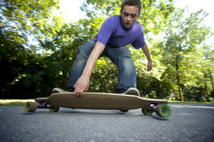 Young teenager rolling around on his longboard Royalty Free Stock Images