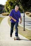 Young teenager rolling around on his longboard Royalty Free Stock Photography