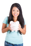 Young teenager saving in her piggybank Royalty Free Stock Image