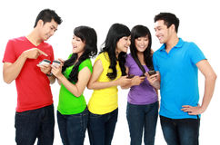 Young teenager using handphone. Group of Teenage Friends hold their handphone Royalty Free Stock Photo