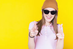 Young teenager wearing a hat and sunglasses Stock Photo