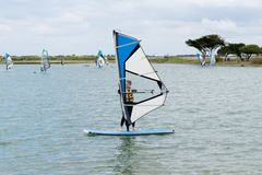 Free Young Teenager Woman Windsurfing On The Lake Of The Island Of Re Windsurf Board Stock Photo - 149814030