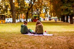 Young teenagers Camping in the autumn Park. Active people concept. Outdoors. stock photography