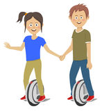 Young teenagers couple riding self balancing unicycle electric scooters Stock Image