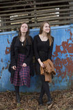 Young  teenagers girls pensively cost about textured wall. Royalty Free Stock Photos