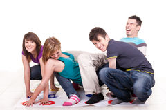 Young teenagers playing twister royalty free stock images