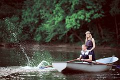 Young couple rowing and splashing on lake stock photos