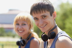 Young teenagers with wireless headphones Stock Image
