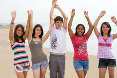 Young teens. Group of young teens playing on beach Royalty Free Stock Image