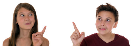 Young teens or children pointing with their finger. Isolated on a white background Royalty Free Stock Photo