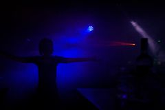 Young teens dancing in an underground club. Silhouettes of people dancing in a dark night club Stock Photography