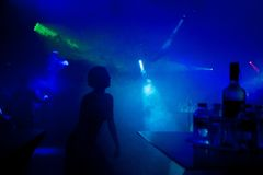 Young teens dancing in an underground club. Silhouettes of people dancing in a dark night club Royalty Free Stock Photos